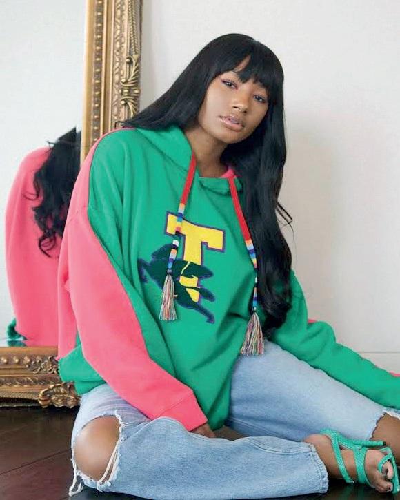 Temi Otedola wearing a sweater