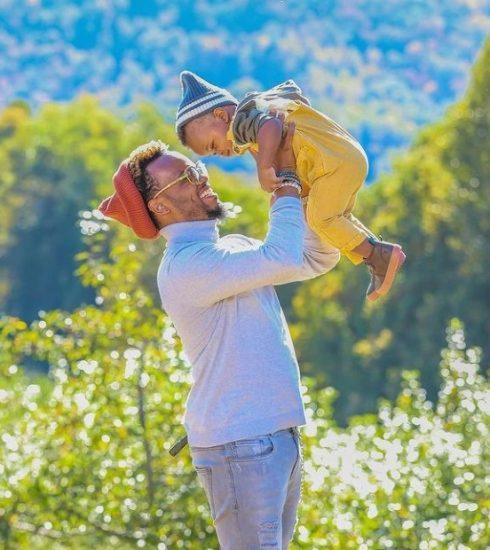 Travis Greene with child